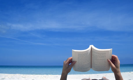 Reading-a-book-on-the-bea-001[1].jpg